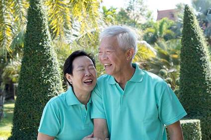 asian periodontal couple walking and holding hands